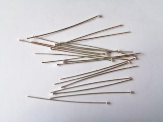 Pack of 20 silver plated headpins. Each headpin measures approximately 5cm. Headpins have a flat nail tip head and are essential findings for jewellery making.